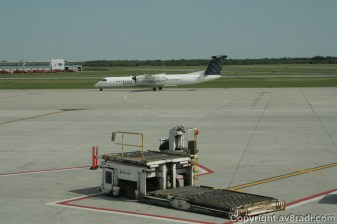 A Porter Airline's Q400 taxing by