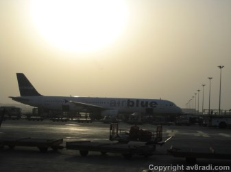 An AirBlue (Pakistan) A321 parked beside my aircraft