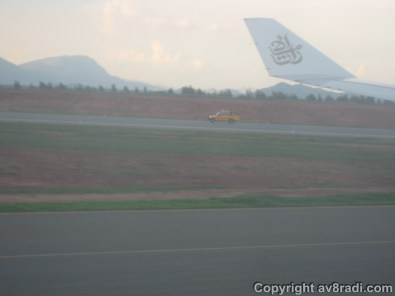 Ground crew inspecting the runway for debris after we landed…