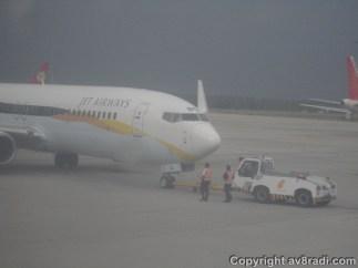 9W Boeing 737-700 pushing back