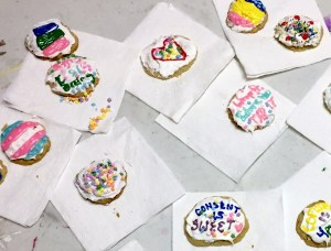 Cookies decorated with slogans about consent.