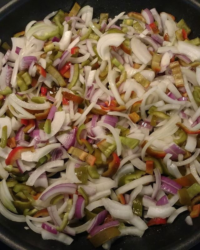 Oh, darn. Have some sweet Italian frying peppers that didn't sell at the farmers market. We'll just have to fry them up with some of our Kinston Sweet onions and Kinston red onions (and a dash of our fresh garlic salt). Oh darn 😀