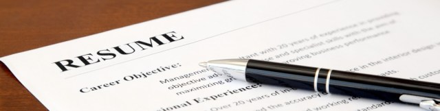 Closeup of Resume with Pen on the Table