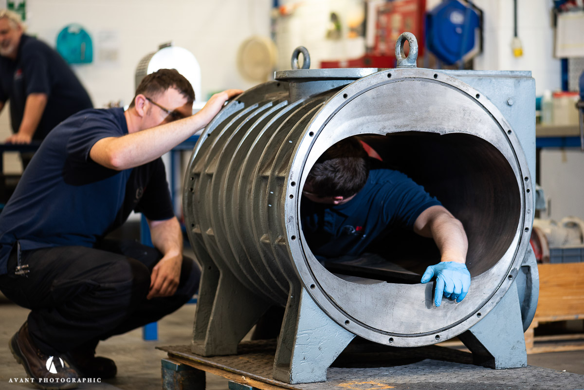Avant Commercial - two engineers are in the casing of a huge pump at AVTPUMP