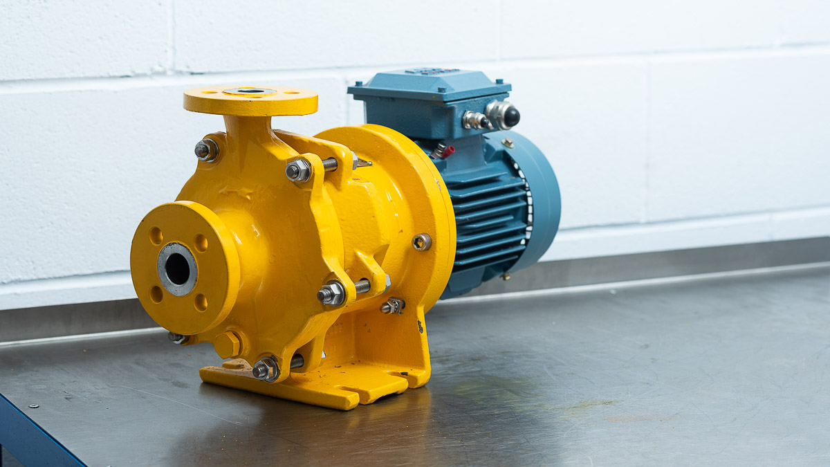 A yellow and grey HMD Sealess Pump on workbench