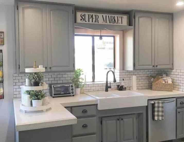 Greyscale Kitchen Cabinet with Subway Tile Backsplash