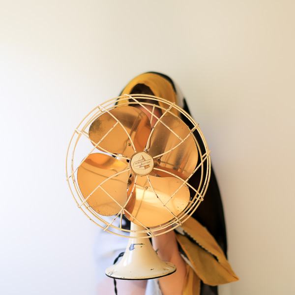 unrecognizable woman holding a fan