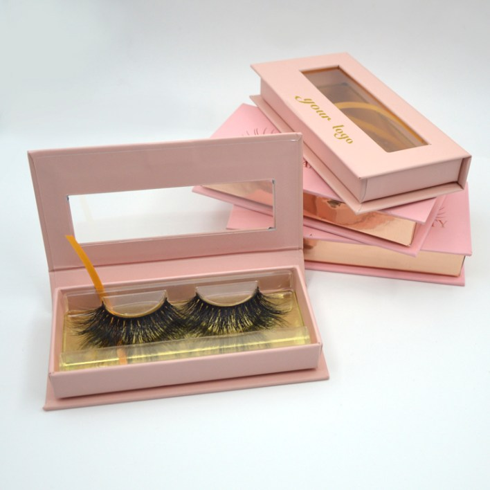three pink rectangular lash boxes
