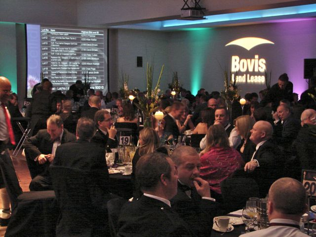 Dinners text bids for auction lots