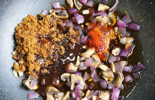 onion, garlic, mushrooms, spices, brown sugar, vinegar in a pan saute