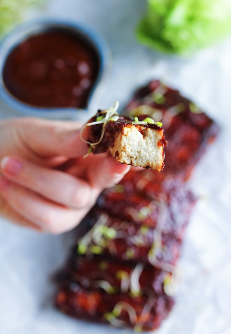 fluffy white inside of the Tofu Ribs with Homemade Spicy BBQ Sauce topped with alpha-alpha sprouts