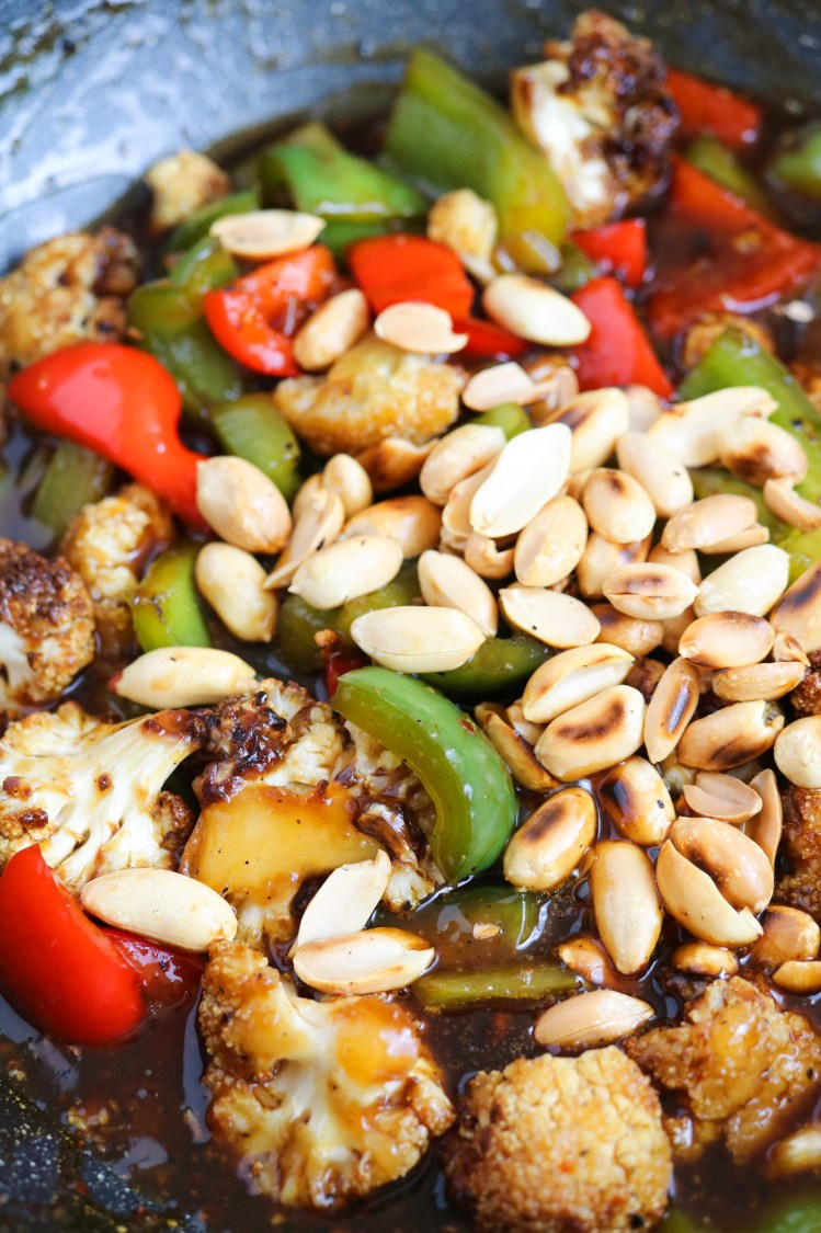 vegan and vegetarian cooked peppers and cauliflower with roasted peanuts for Kung Pao Cauliflower