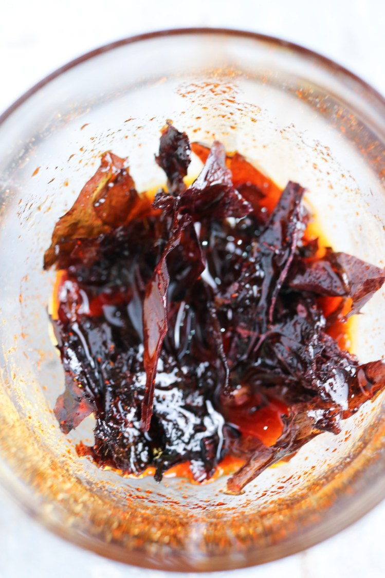 Dulse seaweed marinating with smoked paprika, soy sauce and oil for Butternut Squash Pasta with Crispy Smoked Seaweed