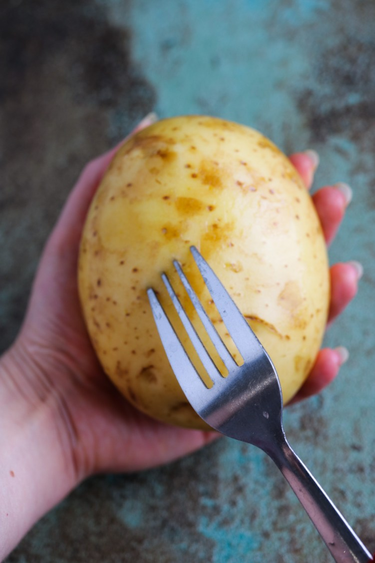 piercing raw potato