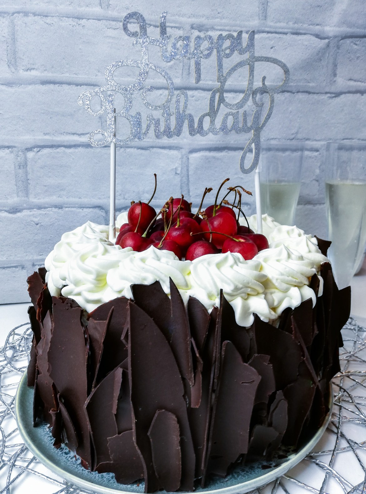 Indulgent, decadent and chocolatey, this vegan black forest cake (or gateau) is a complete plant-based version of the scrumptious German dessert. #vegan #plantbased #chocolate #blackforest #cakes #chocolate #cherries #maraschino #kirsh #temperedchocolate