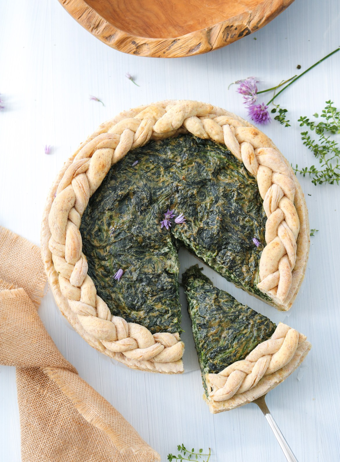 vegan spinach pie with slice cut top down