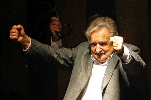 Uruguay's president-elect Jose Mujica celebrates winning the presidential run-off election in Montevideo