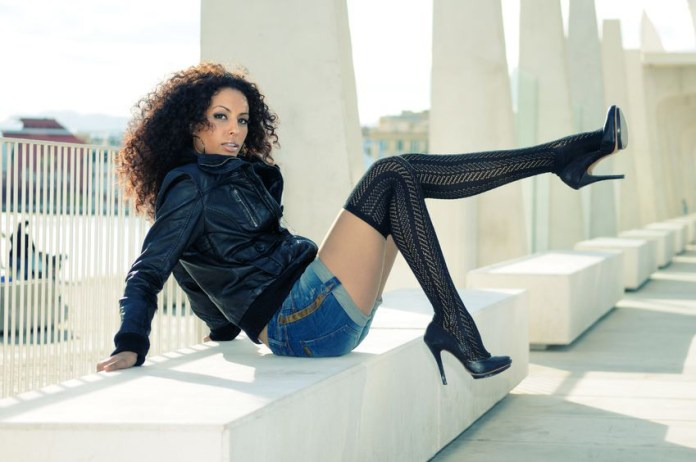 beautiful brunette curly hair brown eyes black leather jacket denim shorts