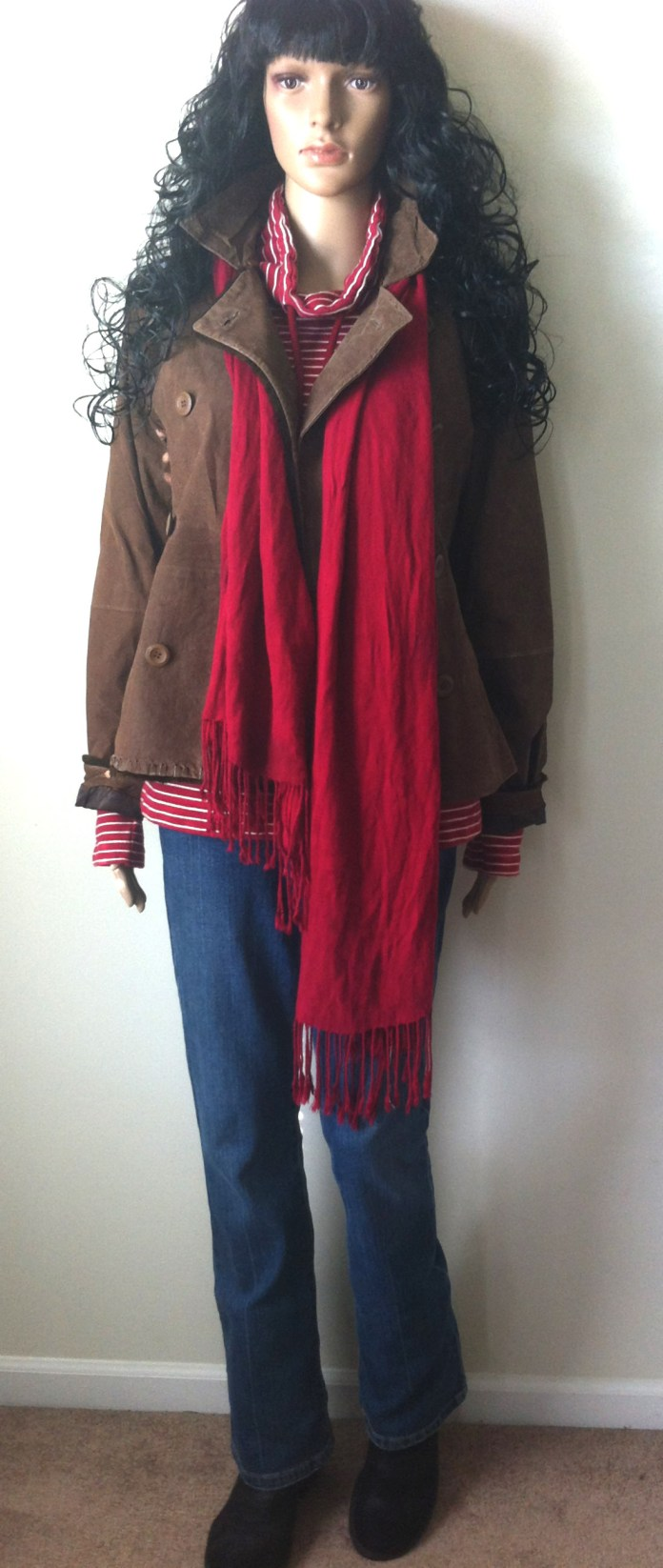 red white striped top brown leather jacket blue jeans black suede buckle boots