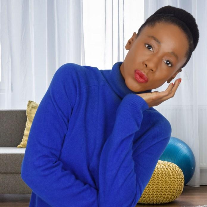 monica wearing her blue turtleneck sweater