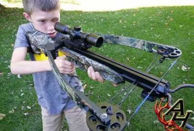 boy shooting crossbow
