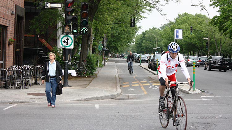 Montreal has many separated bike lanes, making bike helmets much less necessary.