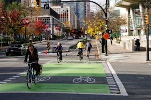 Fall shot of a cyclist on the Dunsmuir Separated Bike Lane - Vancouver Cycling Culture