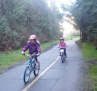 Children cycling on Shoreline Trail, Rocky Point Park. Shoreline Trail in Rocky Point Park, Port Moody, BC, Canada – Guide and videos