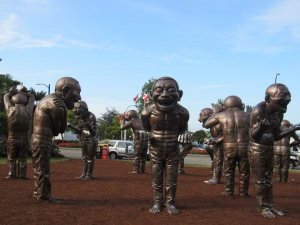A-Maze-ing Laughter sculpture by Yue Minjun - Average Joe Cyclist