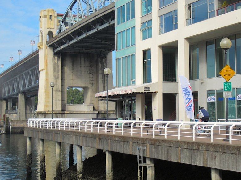 Restaurants under the Burrard Bridge on the Seaside Bike Route, Vancouver