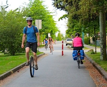 unicyclist on protected bike lane in Vancouver - Average Joe Cyclist