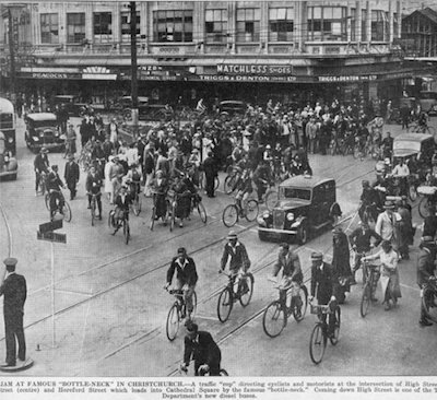 Cyclists in Christchurch, New Zealand, in the early 20th century. Note the flocks of men AND women with bikes, while few isolated cars try to get through. Boy, have times ever changed! But with the way thing are going in cities such as London, Copenhagen, Montreal, Portland and even Vancouver, maybe we will start to see sights like this in the future