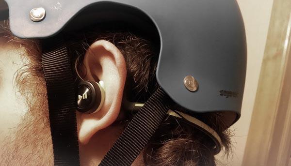 Notice how neatly the Plantronics headphones fit under a helmet