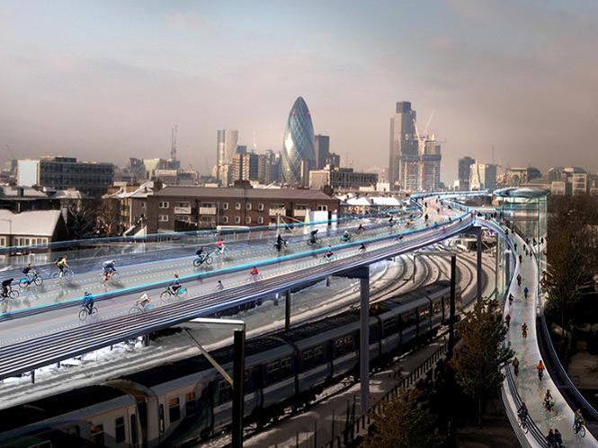 In London, architect Norman Foster has unveiled the concept for an urban cyclist's dream: a car-free stretch of elevated highway made especially for biking. The SkyCycle, which you would pay to access with the city's Oyster farecard, is designed to span more than 130 miles running above suburban rail lines throughout the city. Photograph Courtesy of Foster + Partners, from this web page about bike superhighways.