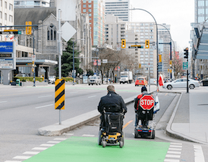 Wheelchairs in Vancouver separate bike lanes