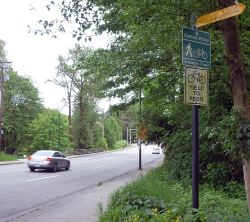 A very unpleasant part of the Central Valley Greenway, where you have to cycle along a narrow sidewalk before crossing North Road at the traffic lights - Central Valley Greenway (CVG) in Metro Vancouver - Guide