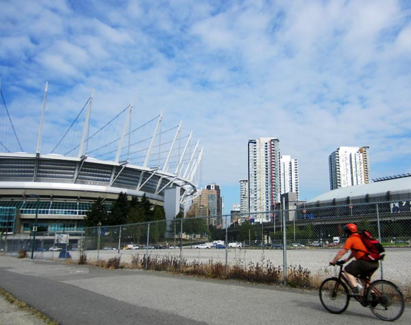 """The Met"" on the Seaside Bike Route, with BC Place in the background"