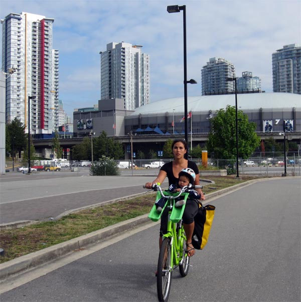 Safe cycling for all on the Seaside Bike Route. In the background is BC Place.