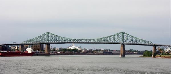 The Jacques Cartier Bridge, with Olympic Stadium in the background - Montreal Cycling