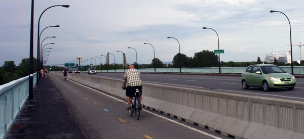 Extra wide lane allows pedestrian and cyclists to mix it up safely on the Jacques Cartier Bridge in Montreal - Montreal cycling