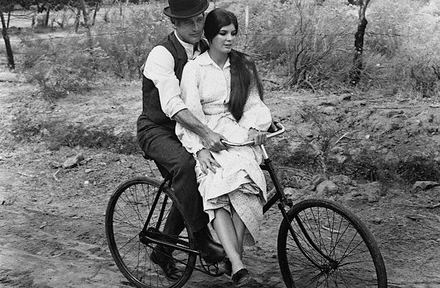 Paul Newman shows how riding a bike may help a guy to get the attention of a beautiful woman (it's because of the bike, NOT because he's Paul Newman)!