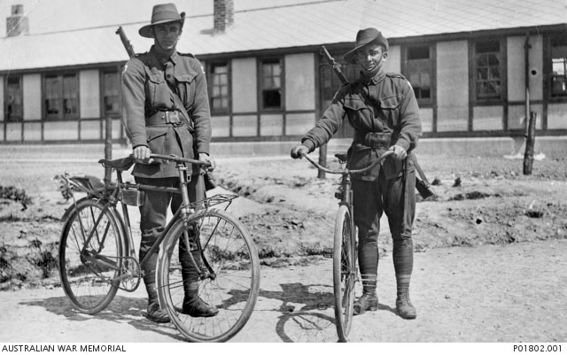 Henencourt, France. 1917-05-12. Two members of the 1st Anzac Cyclists Battalion standing, with their bicycles, in front of their barracks. 827 Private Jack Dair Bambury (left) and 830 Private Herbert (Terry) Davies