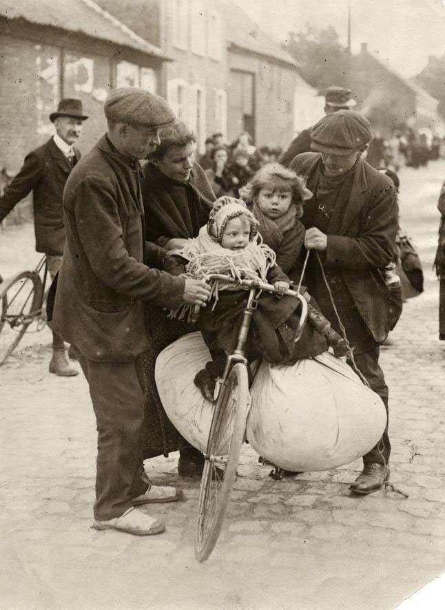 Belgian refugees in Antwerp - a family fleeing the German soldiers on a bicycle. Veterans day. Remembrance Day