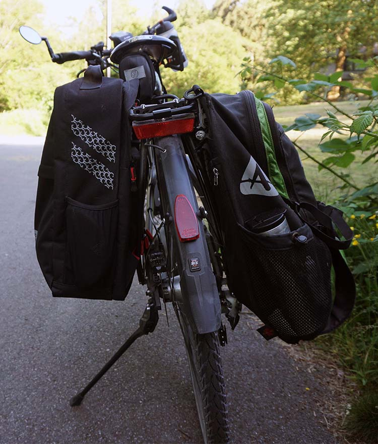 This photo shows the Two Wheel Gear Pannier Backpack Convertible on the left, and the Arkel Bug on the right. I really like the Bug, but the Two Wheel Gear Convertible is my new go-to pannier! Two Wheel Gear Pannier Backpack Convertible Review