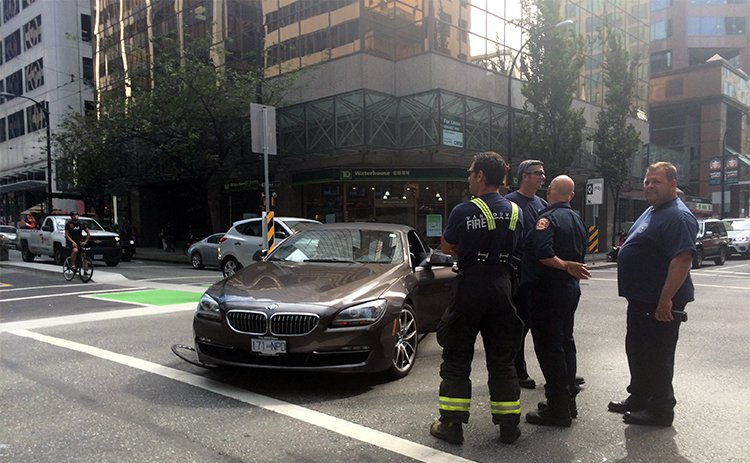 Here's a crash that happened when a driver decided to ignore (or simply was too careless to notice) the sign that says that cars cannot turn right (across the cycle lane) at this intersection. Notice the bicycle wheel under the left side of the car. The cyclist was taken away in an ambulance, the motorist was somewhat inconvenienced
