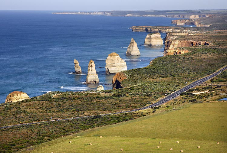Here is an aerial view of the RACV Great Victorian Bike Ride winding past the stunning 12 Apostles. The Twelve Apostles is a collection of limestone stacks off the shore of the Port Campbell National Park, by the Great Ocean Road in Victoria, Australia.