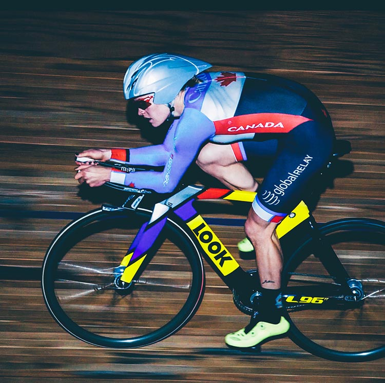 Georgia Simmerling zooming around a track. Despite two serious injuries, Georgia has managed to get back up, and has now been officially selected to compete in Rio with the Canadian Endurance Team Pursuit Cycling Team!