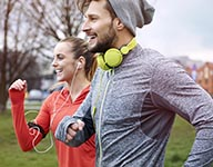 shutterstock-two-runners-with-headphones-table(1)