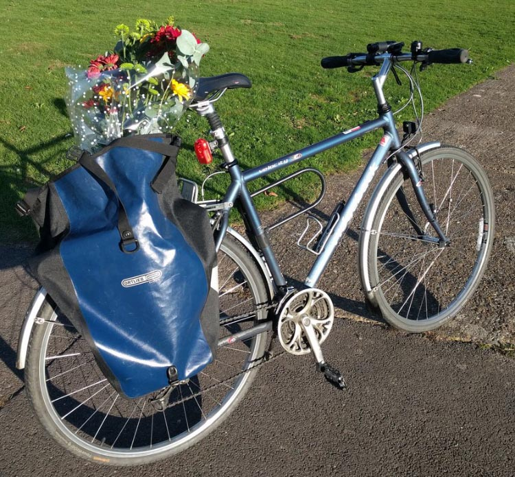 Frances Vernon loves his Ortlieb panniers. In this photo, he records how he used them to bring home flowers to his partner on their anniversary