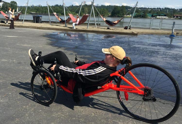 In this photo, my daughter is test riding the Catrike 700 Performance Recumbent Trike Review